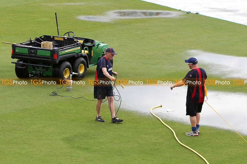 Ground staff start to clear the puddles after torrential rain delays the start of play - Essex Eagles vs Leicestershire Foxes - Clydesdale Bank 40 Cricket at the Ford County Ground, Chelmsford, Essex - 05/08/12 - MANDATORY CREDIT: Gavin Ellis/TGSPHOTO - Self billing applies where appropriate - 0845 094 6026 - contact@tgsphoto.co.uk - NO UNPAID USE.