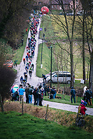 Peloton riding the Haaghoek cobbles<br /> <br /> 75th Omloop Het Nieuwsblad 2020 (BEL)<br /> Men Elite Race<br /> Gent – Ninove: 200km<br /> <br /> ©kramon