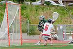 Palos Verdes, CA 04/20/10 - Marc Matsushima (Mira Costa #12) and Grant Cigliano (Palos Verdes #5) in action during the Mira Costa-Palos Verdes boys lacrosse game.