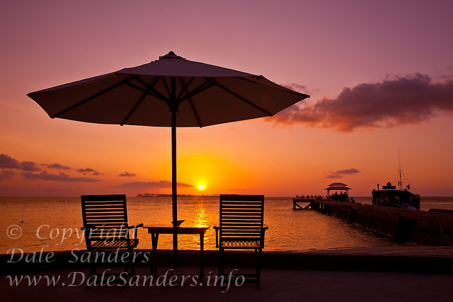 After unset glow, Deck Chairs and Sun Umbrella on the beach at Wakatobi Dive Resort, Southeast Sulawesi, Indonesia.