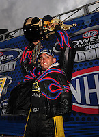 Nov. 1, 2008; Las Vegas, NV, USA: NHRA top fuel dragster driver Tony Schumacher celebrates after clinching the 2008 top fuel championship during qualifying for the Las Vegas Nationals at The Strip in Las Vegas. Mandatory Credit: Mark J. Rebilas-