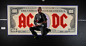 ACDC exhibition at Kelvingrove Art Gallery and Museum - Glasgow - Jim Keatings (who helped set up the exhibition space) mimics his heroes on stage in front of one of the band's iconic notes - picture by Donald MacLeod - 16.9.11 - clanmacleod@btinternet.com 07702 319 738 donald-macleod.com