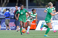 8 November 2015:  Marshall Forward Sydney Arnold (9) advances the ball with North Texas Defender Chelsei Soto (18) in pursuit in the first half as the Marshall University Thundering Herd faced the University of North Texas Mean Green in the Conference USA championship game at University Park Stadium in Miami, Florida.