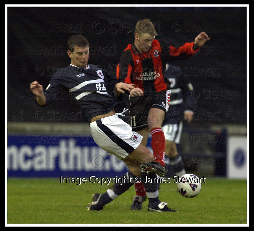 24/11/2001                 Copyright Pic : James Stewart .Ref : DSC_7831                          .File Name : stewart06-raith rovers v clyde.RAITH'S PAUL BROWNE MAKES A CHALLENGE ON CLYDE'S BRIAN CRAWFORD.....James Stewart Photo Agency, Stewart House, Stewart Road, Falkirk. FK2 7AS      Vat Reg No. 607 6932 25.Office     : +44 (0)1324 630007     .Mobile  : + 44 (0)7721 416997.Fax         :  +44 (0)1324 630007.E-mail  :  jim@jspa.co.uk.If you require further information then contact Jim Stewart on any of the numbers above.........