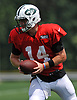 Sam Darnold #14 of the New York Jets gets ready to hand off during Training Camp at the Atlantic Health Jets Training Center in Florham Park, NJ on Tuesday, Aug. 7, 2018.