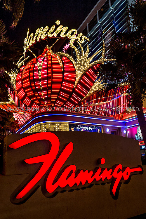 5/13/2015&mdash;Las Vegas, Nevada, USA<br /> <br /> The Flamingo Las Vegas is a hotel and casino located on the Las Vegas Strip in Paradise, Las Vegas, Nevada and is owned and operated by Caesars Entertainment. The property offers a 77,000-square-foot (7,200 m2) casino along with 3,626 hotel rooms. The 15-acre (6.1 ha) site's architectural theme is reminiscent of the Art Deco and Streamline Moderne style of Miami and South Beach, with a garden courtyard housing a wildlife habitat featuring flamingos. It was the third resort to open on the Strip, and it is the oldest resort on the Strip still in operation today.<br /> <br /> Photograph by Stuart Isett<br /> &copy;2015 Stuart Isett. All rights reserved.