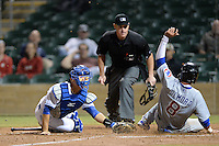 Salt River Rafters catcher Derrick Chung (31), of the Toronto Blue Jays organization, attempts to tag Albert Almora (8) sliding into home as umpire Tom Woodring looks on during an Arizona Fall League game against the Mesa Solar Sox on October 10, 2013 at Salt River Fields at Talking Stick in Scottsdale, Arizona.  Mesa defeated Salt River 8-1.  (Mike Janes/Four Seam Images)