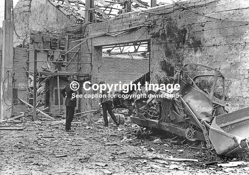 A Garda, Rep of Ireland policeman, and a member of staff survey the damage at a fertiliser factory in Carrigans, Co Donegal, 17th October 1972, following an explosion claimed by the UDA, Ulster Defence Association, a Protestant paramilitary organisation in N Ireland. 19721017536<br />