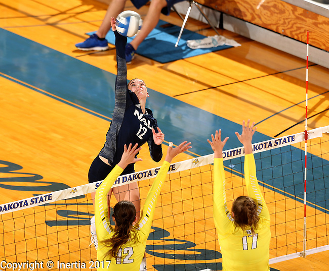 BROOKINGS, SD - SEPTEMBER 1: Kaylie Jorgenson #12 from Northern Arizona looks to get a kill past Taylor Graboski #12 and Peyton McCarthy #17 from Valparaiso during their match Friday afternoon at the Jackrabbit Invitational at Frost Arena in Brookings. (Photo by Dave Eggen/Inertia)