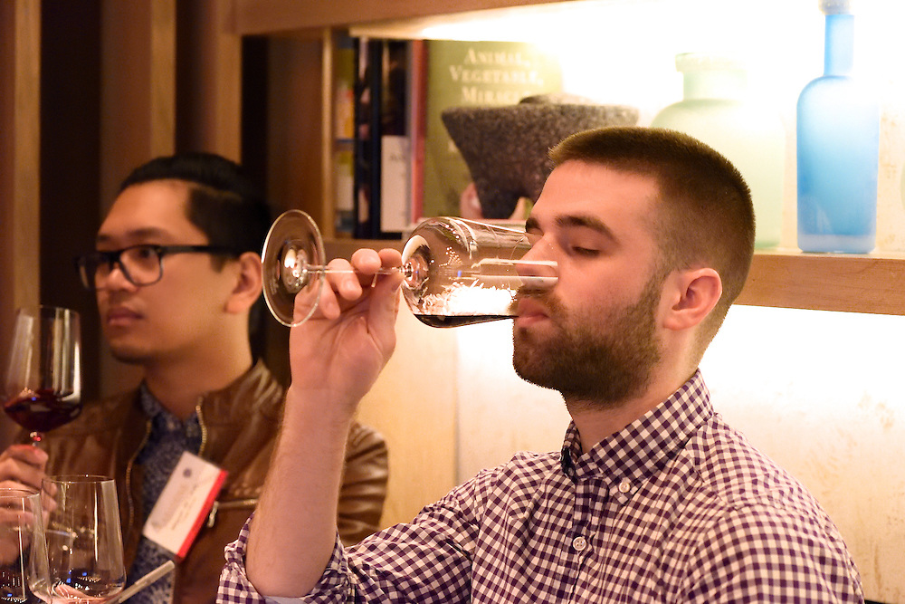 Sampling wines at a tasting event.