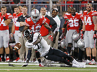 Cincinnati Bearcats wide receiver Mekale McKay (2) fails to catch a pass under pressure from Ohio State Buckeyes cornerback Doran Grant (12) in the third quarter of the college football game between the Ohio State Buckeyes and the Cincinnati Bearcats at Ohio Stadium in Columbus, Saturday afternoon, September 27, 2014. The Ohio State Buckeyes defeated the Cincinnati Bearcats 50 - 28. (The Columbus Dispatch / Eamon Queeney)