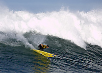 Tyler Smith redirecting during the fourth heat of the 2008 Mavericks contest held at Pillar Point, Half Moon Bay, Calif., Saturday, January 12, 2008.