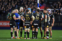 Bath Rugby players huddle together during a break in play. European Rugby Champions Cup match, between Bath Rugby and Wasps on December 19, 2015 at the Recreation Ground in Bath, England. Photo by: Patrick Khachfe / Onside Images