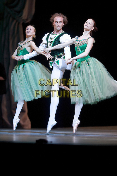 ANASTASIA KOLEGOVA, ANDREI ERMAKOV & EKATERINA KONDAUROVA.The Kirov Ballet perform a dress rehearsal of Jewels by George Balanchine. The first act, Emeralds, is performed in full costume, The Lowry Theatre, Salford Quays, Manchester, England..May 13th, 2008.full length stage dance dancing dancer ballerina tutu white cream tights toes turquoise green top holding hands .CAP/AT.©Alan Towse/Capital Pictures.