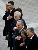 Congressional leaders (L-R) Speaker of the House Paul Ryan (R-WI), Senate Majority Leader Mitch McConnell (R-KY), Senate Minority Leader Chuck Schumer (D-NY) and House Minority Leader Nancy Pelosi (D-CA) watch as a U.S. military honor guard team carries the flag draped casket of former U.S. President George H. W. Bush from the U.S. Capitol December 5, 2018 in Washington, DC. A funeral service will be held today for former U.S. President Bush at the Washington National Cathedral. President Bush will be buried at his final resting place at the George H.W. Bush Presidential Library at Texas A&M University in College Station, Texas. A WWII combat veteran, Bush served as a member of Congress from Texas, ambassador to the United Nations, director of the CIA, vice president and 41st president of the United States. <br /> Credit: Win McNamee / Pool via CNP