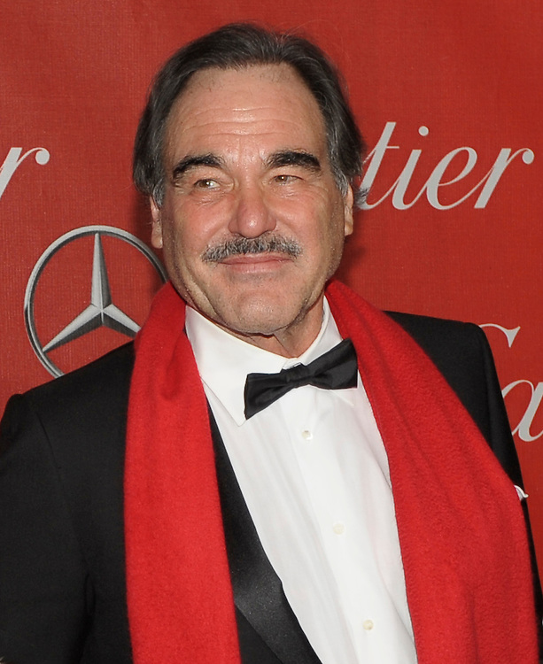 Oliver Stone walks the red carpet prior to giving the Rising Star Award to Jennifer Lawrence during the Palm Springs International Film Festival awards show at the Palm Springs Convention Center on Saturday.