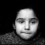 &quot;Tell me one thing you liked to do with your brother?&quot; I asked.<br /> <br /> She let her eyes wander, bit her lip and made as if to think. &quot;I liked walking with him to school.&quot;<br /> <br /> Noor Samoni, sister of 8-year-old Zakaria Hamid Samoni, who was killed by a rocket fired from an Israeli helicopter operating in their neighborhood, laughed when she said this and hid behind her mother.<br /> <br /> &quot;Who will you walk with now?&quot;<br /> <br /> &quot;I don't need to. Mama says that they killed the school as well.&quot;