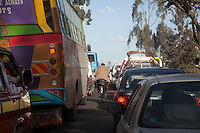 A bicyclist makes his way through a road jam in Nairobi.