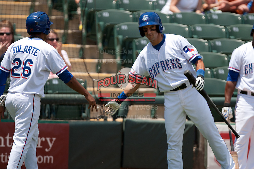 Round Rock Express designated hitter Matt Kata #15 greets his teammate during the Pacific Coast League baseball game against the Memphis Redbirds on May 6, 2012 at The Dell Diamond in Round Rock, Texas. The Express defeated the Redbirds 5-1. (Andrew Woolley/Four Seam Images)