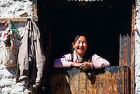 Woman at doorway, Paro, Bhutan