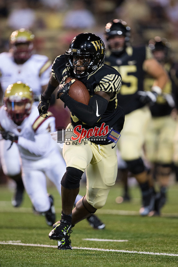 Chuck Wade (89) of the Wake Forest Demon Deacons breaks free to score a touchdown on a 27-yard catch and run during second half action against the Elon Phoenix at BB&T Field on September 3, 2015 in Winston-Salem, North Carolina.  The Demon Deacons defeated the Elon Phoenix 41-3.   (Brian Westerholt/Sports On Film)