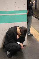 A tired evening commuter. Tokyo has one of the most extensive and efficient transport networks in the world - but also one of the most crowded. Rail companies calculate crowding by percent of standard capacity (ie when all the seats and standing spaces are occupied). Some trains reach 220%+.