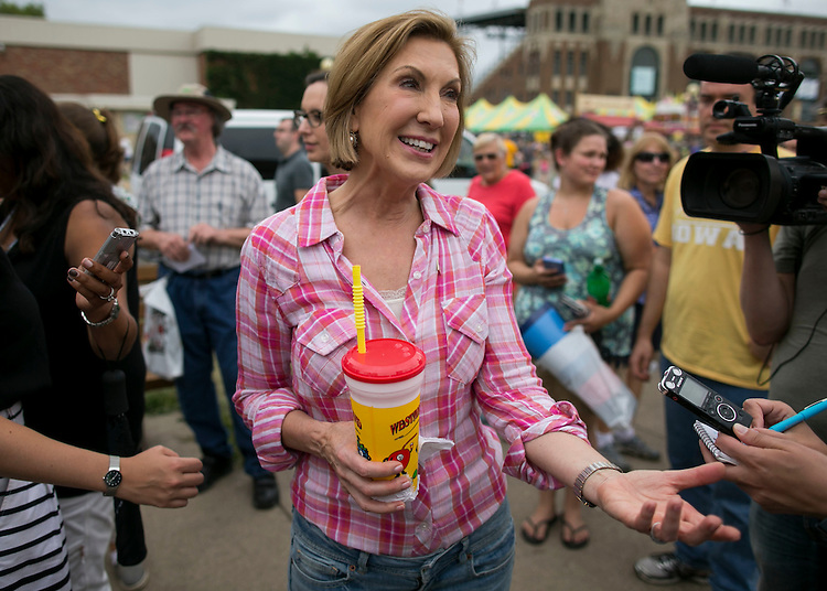 "UNITED STATES - August 17: Republican presidential candidate Carly Fiorina answers questions from reporters while holding her ""diabetic lemonade"" at the Iowa State Fair in Des Moines, Iowa, Monday, August 17, 2015. Florina's husband, Frank, was recently diagnosed with diabetes and Florina has agreed to quit sugar with her husband. (Photo By Al Drago/CQ Roll Call)"