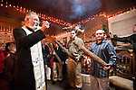 Father Steve swings his censer as he  blesses the Badnjak (blessing of the Yule Logs) following Christmas Eve Vigil Service, St. Sava Serbian Orthodox Church, Jackson, Calif...The three logs represent the Holy Trinity and their burning commemorate the fire the shepherds built in the cave where the Christ was born to warm baby Jesus and his mother Mary during that night.