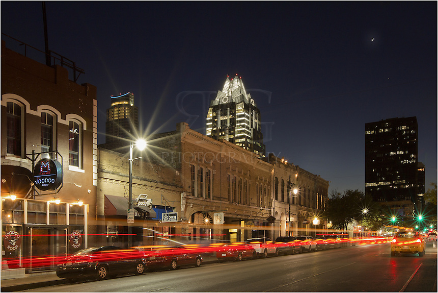 Sixth Street is always alive and active at night. In this view from the sidewalk, you can see the architectural delight of the Frost Tower rising over the buldings that line this street known for its music and partying.