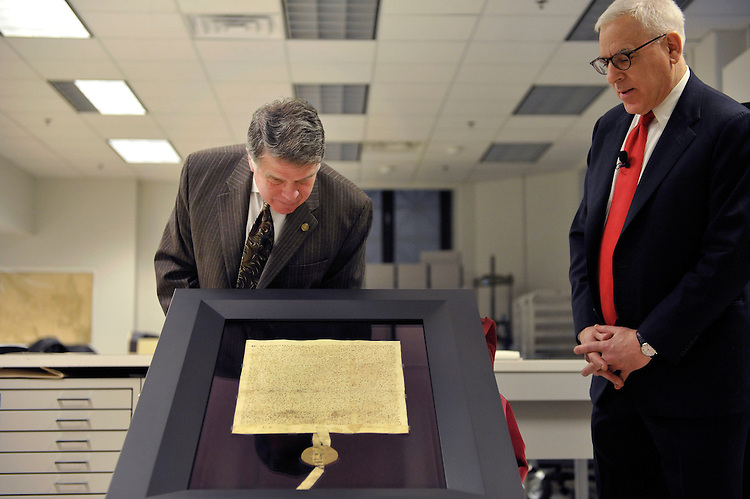 UNITED STATES - FEBRUARY 2: Archivist of the United States David Ferriero; and Carlyle Group Co-Founder and owner of Magna Carta David Rubenstein, unveil the newly re-encased 1297 Magna Carta at the National Archives for a media preview. (Photo By Chris Maddaloni/CQ Roll Call)