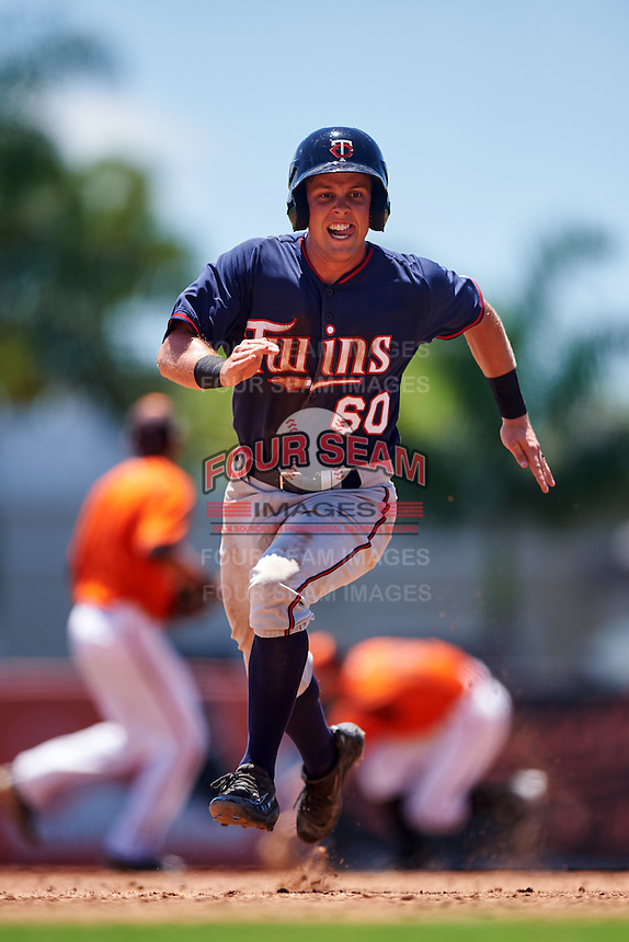 GCL Twins first baseman Brian Olson (60) running the bases during a game against the GCL Orioles on August 11, 2016 at the Ed Smith Stadium in Sarasota, Florida.  GCL Twins defeated GCL Orioles 4-3.  (Mike Janes/Four Seam Images)