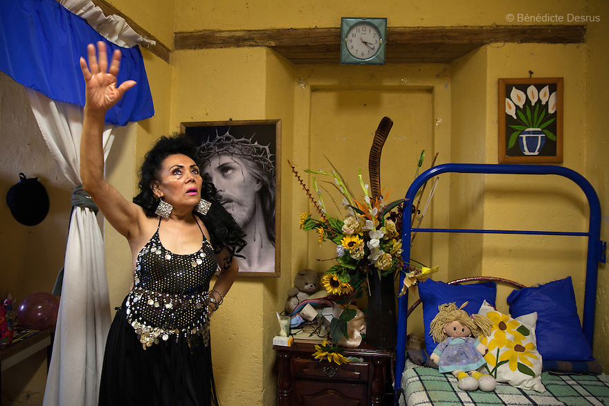 Norma Angelica, a resident of Casa Xochiquetzal, dances and sings in her bedroom at the shelter in Mexico City, Mexico on May 25, 2016. Casa Xochiquetzal is a shelter for elderly sex workers in Mexico City. It gives the women refuge, food, health services, a space to learn about their human rights and courses to help them rediscover their self-confidence and deal with traumatic aspects of their lives. Casa Xochiquetzal provides a space to age with dignity for a group of vulnerable women who are often invisible to society at large. It is the only such shelter existing in Latin America. Photo by Bénédicte Desrus