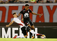 "BUENOS AIRES - ARGENTINA - 05 - 04 - 2018: Gonzalo Montiel (Izq.) jugador de River Plate disputa el balón con Jhon Pajoy (Der.) jugador de Independiente Santa Fe, durante partido de la fase de grupos, grupo D, fecha 2, entre River Plate (ARG) y el Independiente Santa Fe, por la Copa Conmebol Libertadores 2018, en el estadio Antonio Vespucio Liberti ""Monumental de River"", de la ciudad Ciudad Autónoma de Buenos Aires. / Gonzalo Montiel (L) player of River Plate vies for the ball with Jhon Pajoy (R) player of Independiente Santa Fe, during a match of the groups phase, group D, 2nd date, beween River Plate (ARG) and Independiente Santa Fe, for the Conmebol Libertadores Cup 2018, at the Antonio Vespucio Liberti ""Monumental de River"", in Ciudad Autónoma de Buenos Aires.  Photo: VizzorImage / Javier Garcia Martino / Photogamma / Cont."