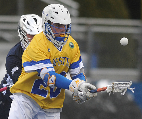 Kyle Gallagher #28 of Hofstra University gains possession of a loose ball during an NCAA men's lacrosse game against Monmouth at Shuart Stadium in Hempstead, NY on Wednesday, March 14, 2018. Hofstra won by a score of 7-6.