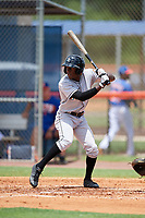 GCL Marlins left fielder Milton Smith (4) at bat during a game against the GCL Mets on August 3, 2018 at St. Lucie Sports Complex in Port St. Lucie, Florida.  GCL Mets defeated GCL Marlins 3-2.  (Mike Janes/Four Seam Images)