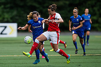 Seattle, WA - Thursday, May 26, 2016: Arsenal Ladies FC defender Josephine Henning (22) and Seattle Reign FC defender Paige Nielsen (12). The Seattle Reign FC of the National Women's Soccer League (NWSL) and the Arsenal Ladies FC of the Women's Super League (FA WSL) played to a 1-1 tie during an international friendly at Memorial Stadium.