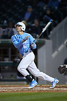 Dylan Enwiller (6) of the North Carolina Tar Heels follows through on his swing against the Charlotte 49ers at BB&T BallPark on March 27, 2018 in Charlotte, North Carolina. The Tar Heels defeated the 49ers 14-2. (Brian Westerholt/Four Seam Images)