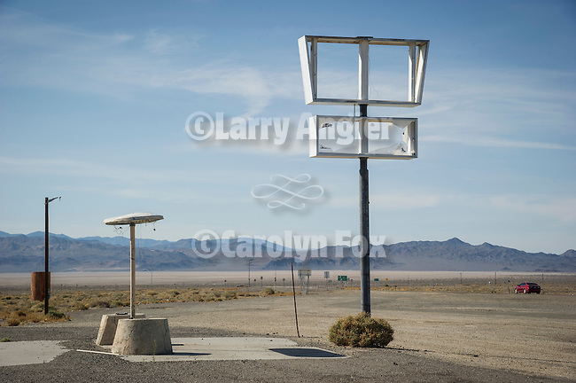 Abandoned roadhouse and gas station at the U.S. Highways 6 and 95 Junction, Coaldal, Nevada<br /> <br /> Sign and light poles