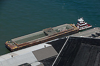 aerial photograph tug boat and barge at San Francisco pier