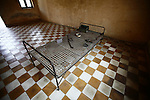 A metal bed frame and artifacts from the Khmer Rouge era occupy a detention cell for high-ranking party cadres at the Tuol Sleng prison in Phnom Penh, Cambodia. As many as 2 million Cambodians -- or one-quarter of the population -- died under the Khmer Rouge from 1975 to 1979. An estimated 17,000 political detainees passed through Tuol Sleng, a former high school converted to a prison by the regime. All but a handful of those were murdered in the Killing Fields after months of brutal interrogation. In these cells, the victims were often tortured and sometimes killed while shackled to the bed frames. March 21, 2012.