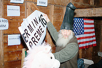 Satirical presidential candidate Vermin Supreme puts up a banner before delivering a stump speech at Ten Rod Farm in Rochester, New Hampshire. Supreme's platform advocates a pony-based economy, using zombies to solve the energy crisis, and other outlandish ideas. Supreme has been on the New Hampshire primary ballot in 2008 and 2012, though he began running for president in 1992. Vermin Supreme will be on the Democratic party ballot in the 2016 New Hampshire primary.