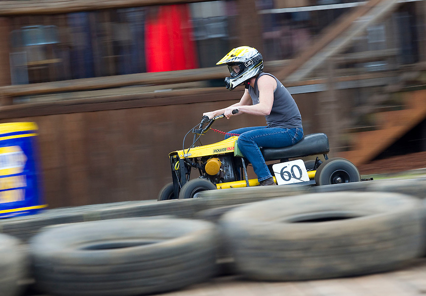 """Courtney Nicholson races a lawn-mower at the annual """"Territorial Days"""" festival in Amboy Sunday July 10, 2016. Other events during the celebration included a logging show, musical performances, an art show and a carnival. The celebration highlights the area's connection to logging and pioneering. (Photo by Natalie Behring/ for the The Columbian)"""