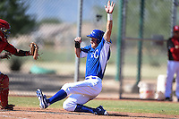 Kansas City Royals outfielder Brandon Downes (45) slides into home during an Instructional League game against the Cincinnati Reds on October 14, 2014 at Goodyear Training Facility in Goodyear, Arizona.  (Mike Janes/Four Seam Images)