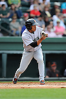 Outfielder Randy Ortiz (14) of the Augusta GreenJackets bats in a game against the Greenville Drive on Sunday, April 12, 2015, at Fluor Field at the West End in Greenville, South Carolina. Augusta won, 2-1. (Tom Priddy/Four Seam Images)