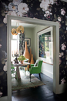 The cool green workspace has a marble table from Retrouvius. Antique chairs were reupholstered in fabric by Manuel Canovas and the rug is from Caravane