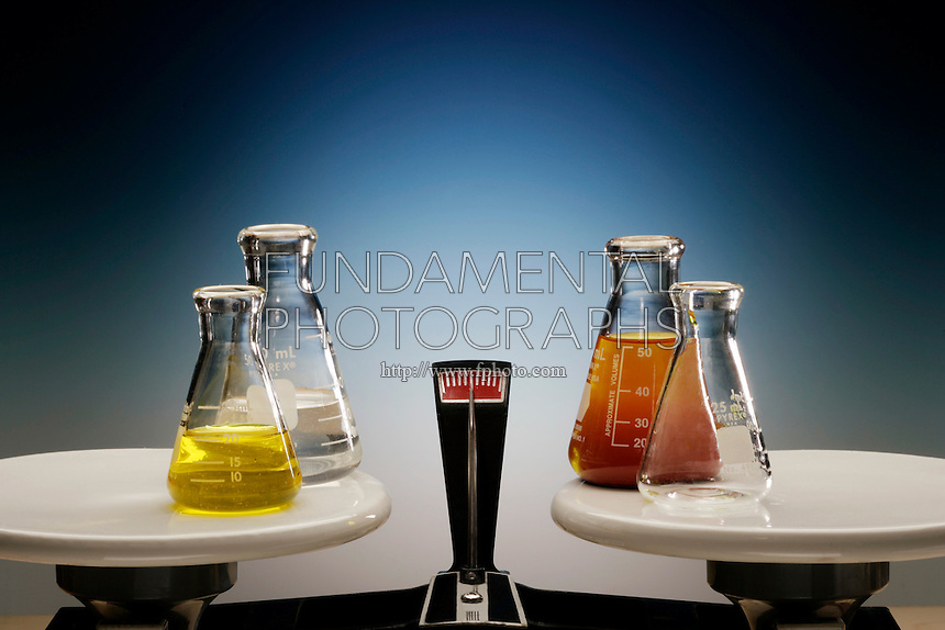 LAW OF CONSERVATION OF MASS- DOUBLE PAN BALANCE<br /> (Variations Available).<br /> Demonstrated By Reaction of K2CrO4 and AgNO3<br /> Yellow 0.1M Potassium Chromate (aq) is added to a clear  0.25M Silver Nitrate (aq) in flasks on the left. Solid red Silver Chromate precipitates  in a solution of Potassium Nitrate on the right. Total mass of each is in balance.