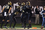 Essang Bassey (21) of the Wake Forest Demon Deacons is congratulated by teammates Ja'Sir Taylor (24), Jaboree Williams (6), and Justin Strnad (23) after intercepting a pass late in the fourth quarter of the game against the North Carolina State Wolfpack at BB&T Field on November 18, 2017 in Winston-Salem, North Carolina.  The Demon Deacons defeated the Wolfpack 30-24.  (Brian Westerholt/Sports On Film)