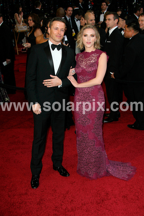 **ALL ROUND PICTURES FROM SOLARPIX.COM**                                             **SYNDICATION RIGHTS FOR UK, AUSTRALIA, DENMARK, PORTUGAL, S. AFRICA, SPAIN & DUBAI (U.A.E) & ASIA (EXCLUDING JAPAN) ONLY**                                                                                  Arrivals for the 83rd Annual Academy Awards, Kodak Theatre, Hollywood, CA, USA.                                                                        .This pic:    Joe Machota and Scarlett Johansson .JOB REF:    12901    PHZ/Evans       DATE: 27.02.11                                                           **MUST CREDIT SOLARPIX.COM OR DOUBLE FEE WILL BE CHARGED**                                                                      **MUST AGREE FEE BEFORE ONLINE USAGE**                               **CALL US ON: +34 952 811 768 or LOW RATE FROM UK 0844 617 7637**