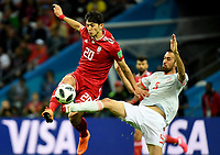 KAZAN - RUSIA, 20-06-2018: Sardar AZMOUN (Izq) jugador de RI de Irán disputa el balón con Sergio BUSQUETS (Der) jugador de España durante partido de la primera fase, Grupo B, por la Copa Mundial de la FIFA Rusia 2018 jugado en el estadio Kazan Arena en Kazán, Rusia. /  Sardar AZMOUN (L) player of IR Iran fights the ball with Sergio BUSQUETS (R) player of Spain during match of the first phase, Group B, for the FIFA World Cup Russia 2018 played at Kazan Arena stadium in Kazan, Russia. Photo: VizzorImage / Julian Medina / Cont