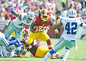 Washington Redskins running back Matt Jones (31) carries the ball during second quarter action against the Dallas Cowboys at FedEx Field in Landover, Maryland on Sunday, September 18, 2016.  Dallas Cowboys defensive tackle David Irving (95) and strong safety Barry Church (42) pursue on the play.<br /> Credit: Ron Sachs / CNP